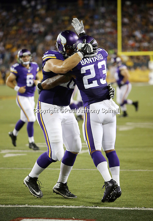 Minnesota Vikings running back Joe Banyard (23) celebrates with a teammate after running for a one yard touchdown that gives the Vikings a 14-3 lead in the third quarter during the 2015 NFL Pro Football Hall of Fame preseason football game against the Pittsburgh Steelers on Sunday, Aug. 9, 2015 in Canton, Ohio. The Vikings won the game 14-3. (©Paul Anthony Spinelli)