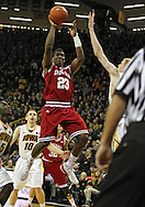 December 31 2012: Indiana Hoosiers guard Remy Abell (23) puts up a shot in front of Iowa Hawkeyes forward Aaron White (30) during the second half of the NCAA basketball game between the Indiana Hoosiers and the Iowa Hawkeyes at Carver-Hawkeye Arena in Iowa City, Iowa on Monday December 31, 2012. Indiana defeated Iowa 69-65.