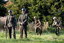 Reenactors portraying US Airborne troops sneak up on German sentries during a small scale Skirmish at the Northallerton Wartime weekend charity fundraiser for Help for Heros and Ben Hyde Memorial Trust 9th &10th Ocober 2010 .Images <br />