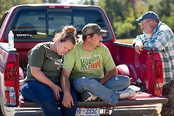 From left, Jennifer Bibey, DJ Bryant and Rickey Bibey rest on the back of a pickup truck after being evacuated from their homes on Tuesday, October 11, 2016, in Vass, NC, USA, Residents in harms way of a potential Woodlake Dam failure were notified of a mandatory evacuation last night. The Bibey's and Bryant opted out of staying in a shelter because they would not be able to bring their pets with them. Photo by Jill Knight/Raleigh News & Observer/TNS/ABACAPRESS.COM