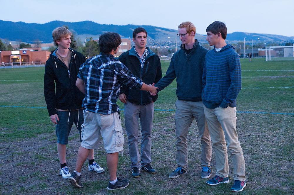 Students and soccer team mates of German exchange student, Diren Dede, who was slain on April 27, 2014, greet each other at Dede's candlelight vigil at the Fort Missoula soccer field where Dede played. L-R: Kyle Higgins, Nathan Mahler, Macky Scott, Chaucer Larson, Garret Leach.