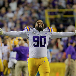 Oct 12, 2019; Baton Rouge, LA, USA; LSU Tigers defensive lineman Rashard Lawrence (90) reacts after a defensive stop against the Florida Gators during the second half at Tiger Stadium. Mandatory Credit: Derick E. Hingle-USA TODAY Sports