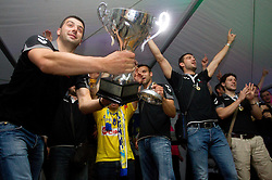 Vladimir Osmajic of Cimos Koper, Matjaz Brumen of Cimos Koper, Bojan Skoko of Cimos Koper, Ziga Smolnik of Cimos Koper and fans celebrate  after the handball match between RK Cimos Koper (SLO) and SL Benfica (POR) in return final match of EHF Challenge Cup, on May 22, 2011 in Tent at Arena Bonifika, Koper, Slovenia. Koper defeated Benfica 31-27 and became Euro Challenge Champion 2011. (Photo By Vid Ponikvar / Sportida.com)