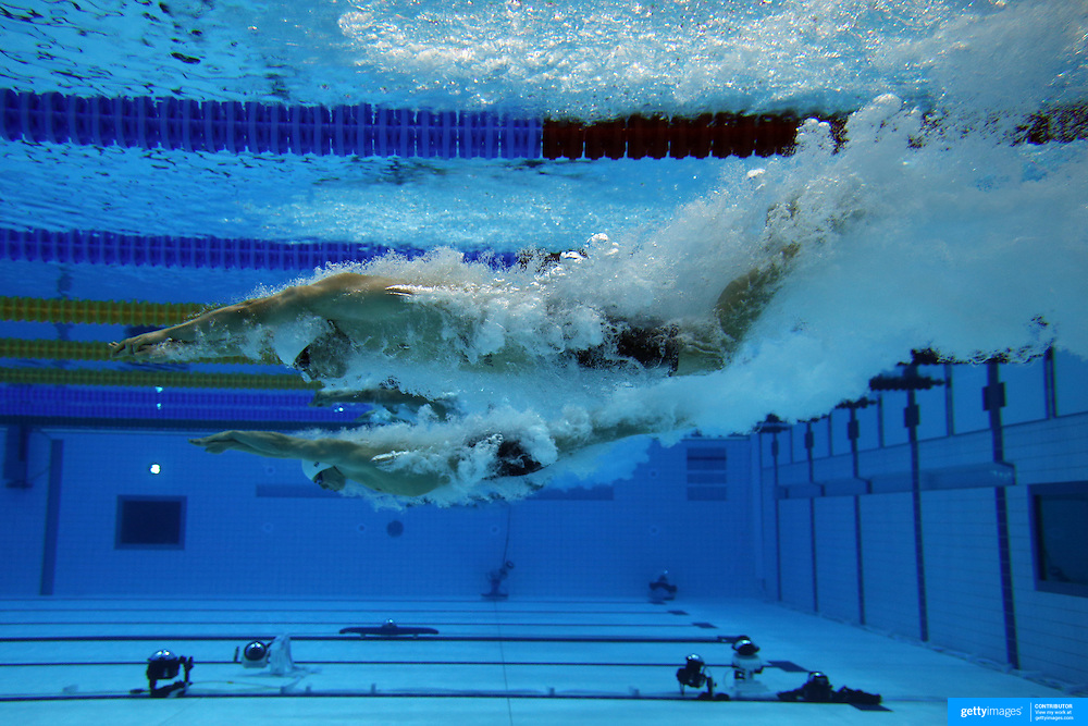 an underwater view of the start of the mens 50m freestyle heats at the aquatic centre