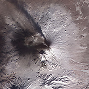 Satellite image of eruption of Kliuchevskoi or Klyuchevskaya Sopka volcano, Kamchatka Peninsula, Russia, 2010.  Has been active almost continuously since its first recorded eruption in 1697. Credit NASA. Science Geology Vulcanology
