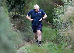 © Licensed to London News Pictures. 11/09/2018. Thame, UK. Boris Johnson checks his watch as he returns from a morning run at his Oxfordshire house . Last week it was announced that Boris Johnson and his wife Marina Wheeler are getting divorced. Photo credit: Peter Macdiarmid/LNP