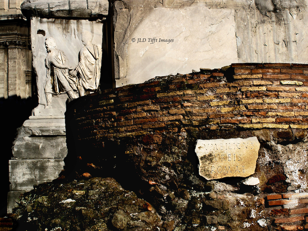 """""""Umbilicus Urbis Romae"""" inscription on a marble  plaque fragment attached to the side of the ancient speakers' platform near the arch of Septimus Severus, Roman Forum.  ..."""