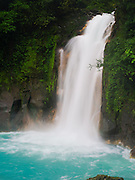 The beautiful turquoise waterfall on the Rio Celeste, Tenorio Volcano National Park, Costa Rica.