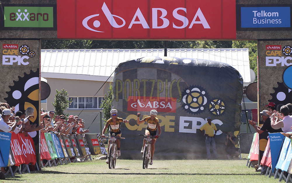 Burry Stander & Christoph Sauser of the 36One-Songo-Specialized team celebrate after winning the 1st Stage during stage 1 of the 2012 Absa Cape Epic Mountain Bike stage race held from Robertson Primary School in Robertson, South Africa on the 26 March 2012..Photo by Shaun Roy/Cape Epic/SPORTZPICS