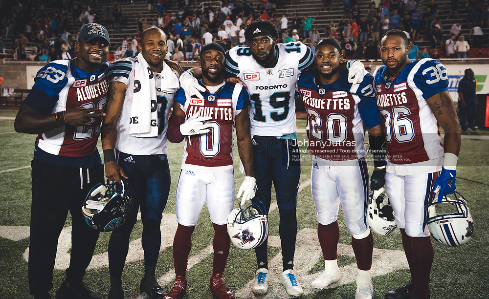 Of the Montreal Alouettes, Brandon Rutley (23), Stefan Logan (0), Tyrell Sutton (20) and Daryl Townsend (36) and of the Toronto Argonauts Brandon Whitaker (3) and SJ Green (19) after the game at Percival-Molson Stadium in Montreal, QC, Friday, August 11, 2017. (Photo: Johany Jutras)