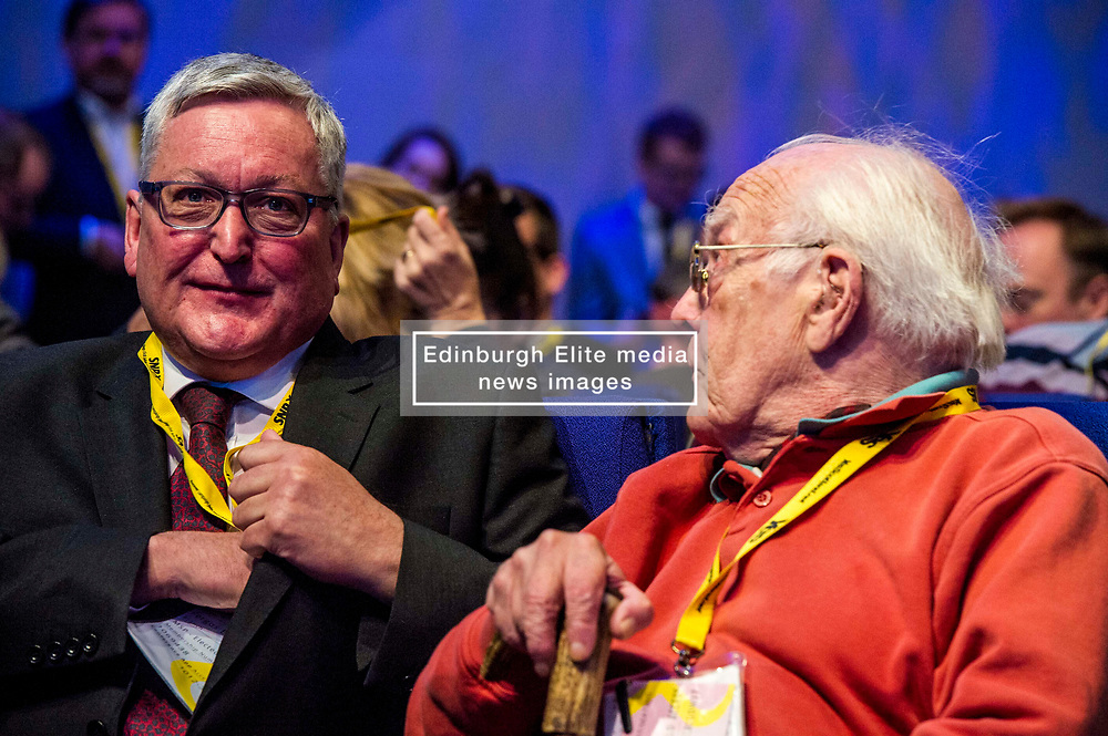 Pictured: Fergus Ewing; MSP; Cabinet Secretary for the Rural Economy and Connectivity chats to old adversary and party veteran Gerry Fisher.<br /> The members of the SNP gathered in the Scottish Events Centre in Glasgow for their annual conference.<br /> <br /> The Ger Harley | EEm 9 October 2017