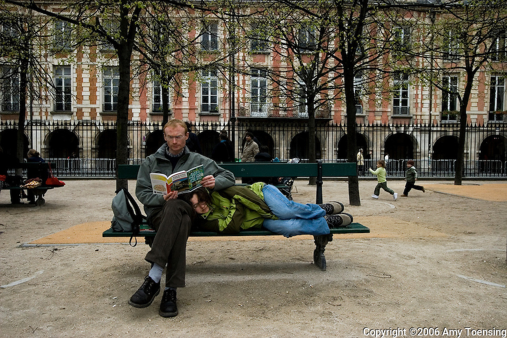 PARIS, FRANCE - APRIL 16: A woman takes a nap on her husband's lap on a bench in Place des Vosges April 16, 2006 in Paris, France.  Half the world's population now lives in cities, and this proportion is expected to grow by sixty percent in the next twenty-five years. Urban parks are valued as public spaces that enhance almost everything about the cities they serve, from job opportunities, youth development, public health, community building and an appreciation for nature and conservation. Since most urban dwellers experience nature through city park systems, these slices of green take on more and more value. The city of Paris has over four hundred parks, ranging from the 2,000 acre Bois de Boulogne, to the Jardin d'Acclimatation for children, to the Promenade Plantee, the only elevated park in the world. (Photo by Amy Toensing) _________________________________<br />