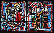 Fulbert's piety to the Virgin Mary (left) with Fulbert worshipping the Virgin and child, and a builder at work on the new cathedral after the fire of 1020 (right), from the Life of Fulbert stained glass window, in the south transept of Chartres Cathedral, Eure-et-Loir, France. This window replaces the original 13th century window depicting the Life of St Blaise, which was destroyed in 1791. It was created in 1954 by Francois Lorin as a gift of the Institute of American Architects, on a theme chosen by the Canon Yves Delaporte. It depicts the life of Fulbert, bishop of Chartres in the 11th century. Chartres cathedral was built 1194-1250 and is a fine example of Gothic architecture. Most of its windows date from 1205-40 although a few earlier 12th century examples are also intact. It was declared a UNESCO World Heritage Site in 1979. Picture by Manuel Cohen