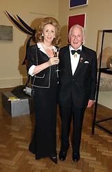 LORD & LADY WOLFSON OF MARYLEBONE at The Royal Academy dinner before the official opening of the Summer Exhibition held at the Royal Academy of Art, Burlington House, Piccadilly, London W1 on 6th June 2006.<br />