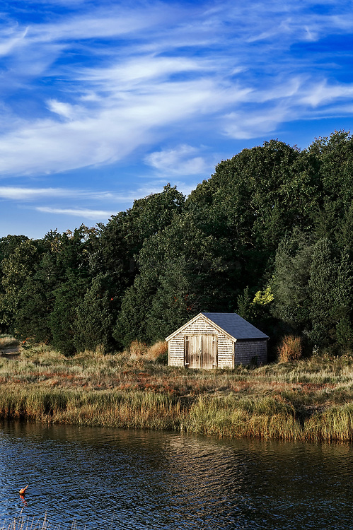 Boathouse on salt pond, Nauset Marsh, Eastham, Cape Cod, MA, Massachusetts, USA