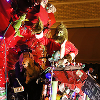 Adam Robison | BUY AT PHOTOS.DJOURNAL.COM<br /> The Grinch drives his sleigh as he waves to the crowd during the Tupelo Christmas Parade Friday night.