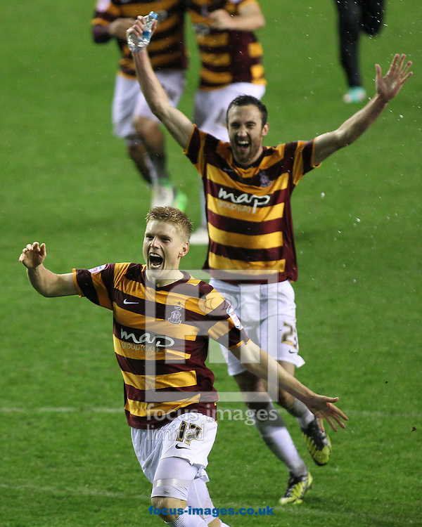 Picture by Michael Sedgwick/Focus Images Ltd +44 7900 363072.30/10/2012.Alan Connell and Rory McArdle of Bradford City celebrate after Jordi Gomez misses his penalty resulting in Bradford beating Wigan Athletic during the Capital One Cup match at the DW Stadium, Wigan.