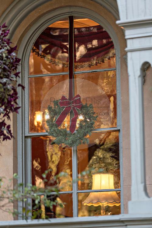 Christmas wreath on window in historic Savannah, GA.