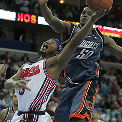 10 December 2008: New Orleans Hornets guard Devin Brown (23) shoots as Charlotte Bobcats center Emeka Okafor (50) defends during a 105-89 win by the New Orleans Hornets over the Charlotte Bobcats on a Hardwood Classics Night as the Hornets honored the 40th Anniversary the 1967-68 New Orleans Bucs ABA franchise at the New Orleans Arena in New Orleans, LA. .
