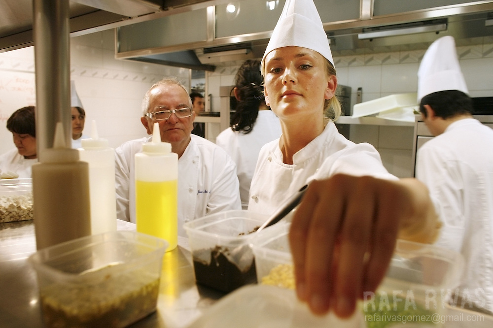 Danish young chef Mie Bostlund (2R) works next to Spanish Basque top chef Juan Mari Arzak (3L) at his restaurant Arzak, on July 03, 2008, in the northern Spanish Basque city of San Sebastian.