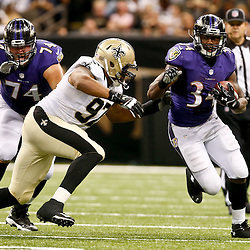 Aug 28, 2014; New Orleans, LA, USA; Baltimore Ravens running back Lorenzo Taliaferro (34) runs as New Orleans Saints defensive end Glenn Foster (97) pursues during the first half of a preseason game at Mercedes-Benz Superdome. Mandatory Credit: Derick E. Hingle-USA TODAY Sports