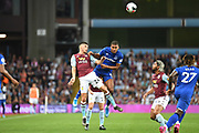 Everton forward Dominic Calvert-Lewin (9) heads the ball  under pressure from Aston Villa defender Frederic Guilbert (24) during the Premier League match between Aston Villa and Everton at Villa Park, Birmingham, England on 23 August 2019.