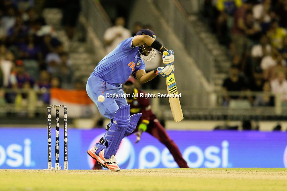 06.03.2015. Perth, Australia. ICC Cricket World Cup. India versus West Indies. Suresh Raina defends during his innings of 22.