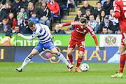 Cardiff City striker Tom Lawrence battles for the ball with Reading FC defender Andrew Taylor during the Sky Bet Championship match between Reading and Cardiff City at the Madejski Stadium, Reading, England on 19 March 2016. Photo by Mark Davies.