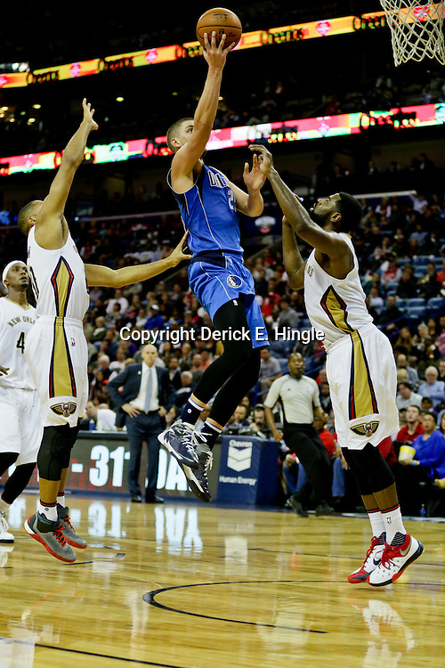 Jan 6, 2016; New Orleans, LA, USA; Dallas Mavericks forward Chandler Parsons (25) shoots over New Orleans Pelicans guard Tyreke Evans (1) and guard Eric Gordon (10) during the second quarter of a game at the Smoothie King Center. Mandatory Credit: Derick E. Hingle-USA TODAY Sports