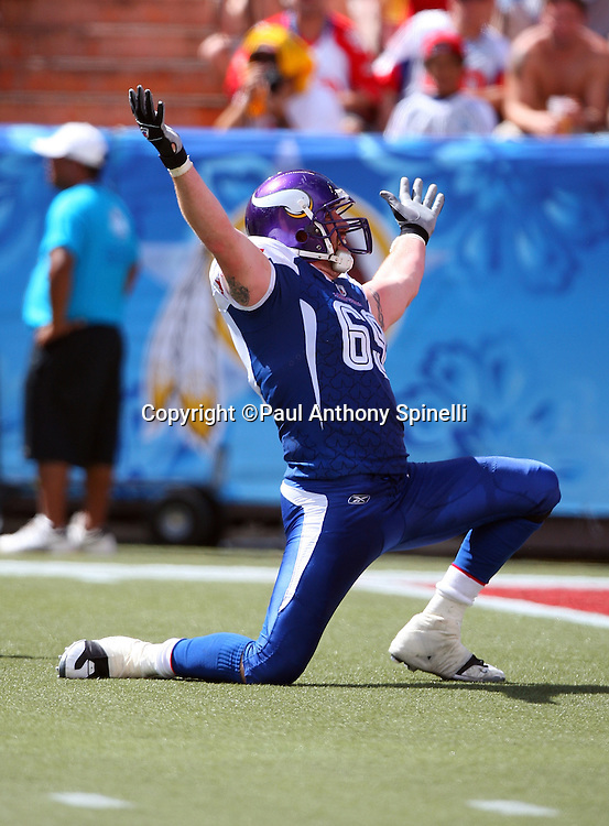 HONOLULU, HI - FEBRUARY 08: NFC All-Stars defensive end Jared Allen #69 of the Minnesota Vikings raises his arms in celebration after stripping and recovering a fumble by the AFC All-Stars in the 2009 NFL Pro Bowl at Aloha Stadium on February 8, 2009 in Honolulu, Hawaii. The NFC defeated the AFC 30-21. ©Paul Anthony Spinelli *** Local Caption *** Jared Allen