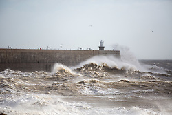@Licensed to London News Pictures 23/02/17. Waves created by Storm Doris hit the Harbour Arm at Folkestone in Kent. Severe weather warnings have been issued for most of the UK as Storm Doris arrived with up to 100mph winds forecast. Photo credit: Manu Palomeque/LNP