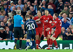 LIVERPOOL, ENGLAND - Sunday, October 7, 2018: Liverpool's Dejan Lovren appeals to referee Martin Atkinson after a penalty is awarded during the FA Premier League match between Liverpool FC and Manchester City FC at Anfield. (Pic by David Rawcliffe/Propaganda)