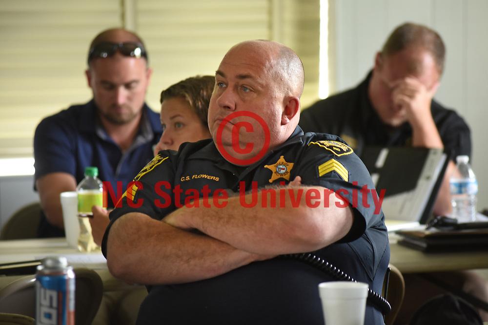Deputy C.S. Flowers of the Rowan County Sheriff's Department listens to information regarding hemp.