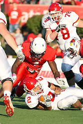 15 October 2011: Dante Warren smothered by Nate Palmer during an NCAA football game between the University of South Dakota Coyotes and the Illinois State Redbirds (ISU) at Hancock Stadium in Normal Illinois.