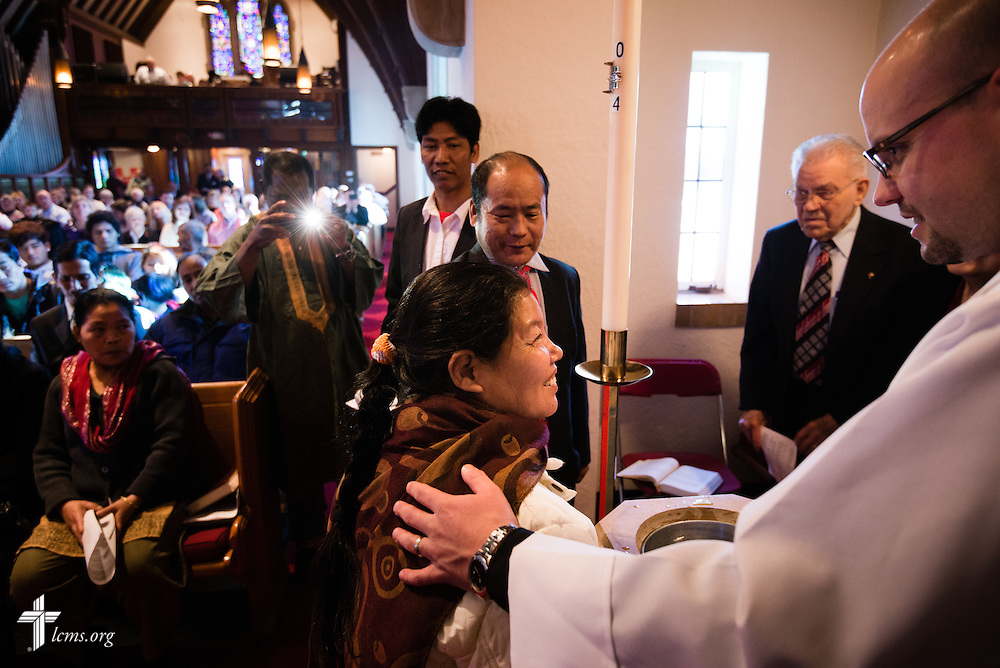 The Rev. Matthew Clark baptizes 21 Nepali immigrants, including Aita Gurung, on Sunday, Jan. 12, 2014, at Ascension Lutheran Church in St. Louis, Mo. LCMS Communications/Erik M. Lunsford