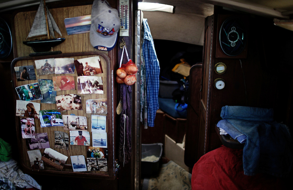 Below deck on Gerry Raccuia's boat, is a panel of photos from his years at sea.