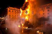 Foguera monument at City hall burning at san Joan night, Hogueras de San Juan, Fogueres de Sant Joan festival. Alicante City, Costa Blanca, Spain, Europe.