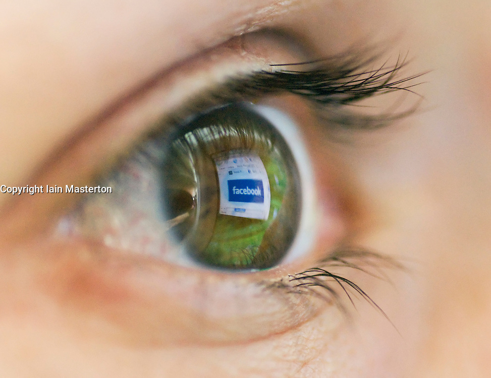 Facebook social networking website reflected on eye