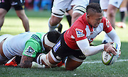 Lions v Highlanders. Elton Jantjies of the Emirates Lions dives over for his try with Ash Dixon of the Highlanders too late to stop him during the 2016 Super Rugby semi-final match at Ellis Park, Johannesburg, 30 July 2016. <br /> <br /> © Anton de Villiers / www.photosport.nz