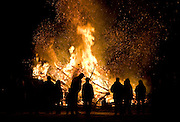 WOODBURY, CT - 17 JANUARY 2009 -011709JT01-.Spectators gather around a giant bonfire on Quassuk Road in Woodbury during the Woodbury Volunteer Fire Department's annual Twelfth Night Christmas Tree Burn on Saturday..Josalee Thrift / Republican-American