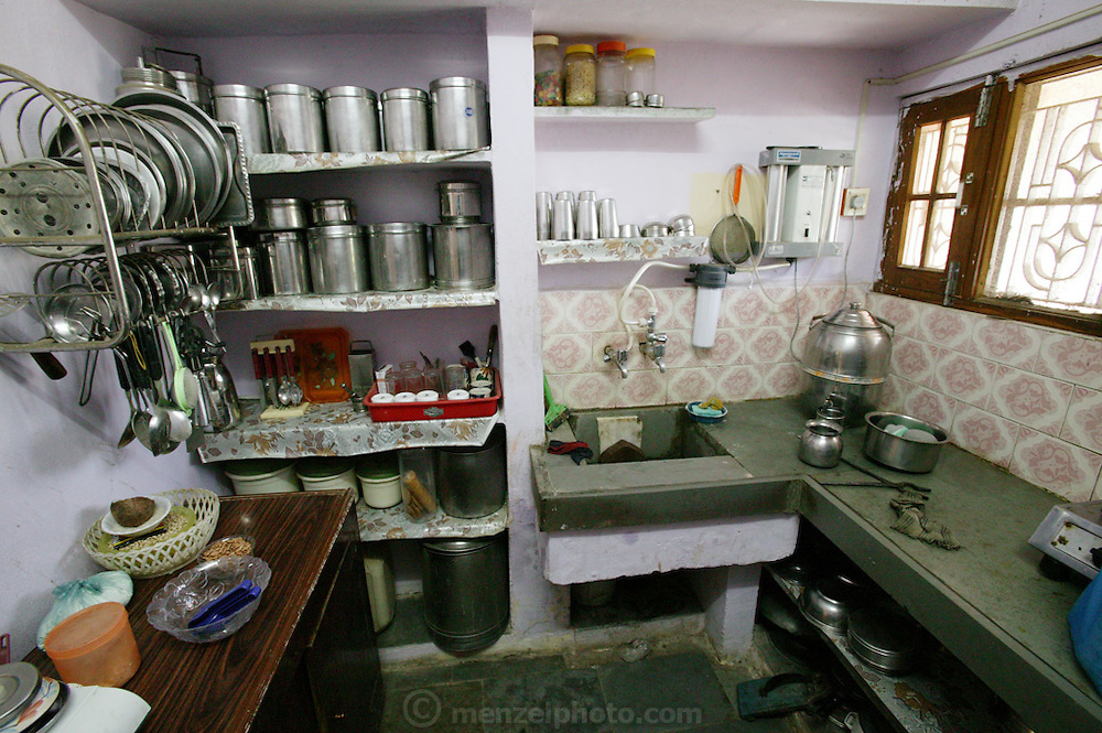 Sangeeta Patkar's small, yet carefully organized kitchen. (Supporting image from the project Hungry Planet: What the World Eats.) The Patkar family of Ujjain, Madhya Pradesh, India, is one of the thirty families featured, with a weeks' worth of food, in the book Hungry Planet: What the World Eats.