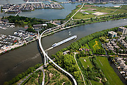 Nederland, Amsterdam, IJburg, 25-05-2010. Nesciobrug over Amsterdam-Rijnkanaal naar Diemerzeedijk (Diemerpark) en Haveneiland. De fiets- en voetgangersbrug is een  combinatie van hangbrug en tuibrug.luchtfoto (toeslag), aerial photo (additional fee required).foto/photo Siebe Swart