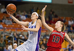Fairmont Senior center Emily Stoller (23) shoots over Bridgeport forward Hannah Fetty (10) during a first round game at the Charleston Civic Center.
