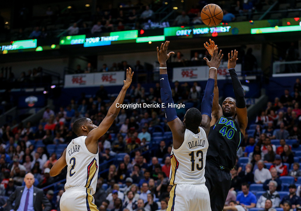 Mar 20, 2018; New Orleans, LA, USA; Dallas Mavericks forward Harrison Barnes (40) shoots over New Orleans Pelicans forward Cheick Diallo (13) and guard Ian Clark (2) during the first quarter at the Smoothie King Center. Mandatory Credit: Derick E. Hingle-USA TODAY Sports