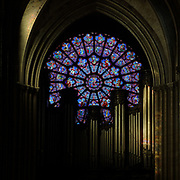 West rose window, originally made 1225, with the Virgin in the central medallion and around, the labours of the months, signs of the zodiac, Virtues and Vices and prophets, in the Cathedrale Notre-Dame de Paris, or Notre-Dame cathedral, built 1163-1345 in French Gothic style, on the Ile de la Cite in the 4th arrondissement of Paris, France. The rose window was completely restored 1844-67 under Jean Baptiste Lassus and Viollet-le-Duc, by master glaziers Alfred Gerente, Louis Steinhel, Antoine Husson, Charles Laurent Marechal and A N Didron the Elder. Picture by Manuel Cohen