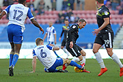 Max Power challenges Matty Done during the EFL Sky Bet League 1 match between Wigan Athletic and Rochdale at the DW Stadium, Wigan, England on 24 February 2018. Picture by Daniel Youngs.