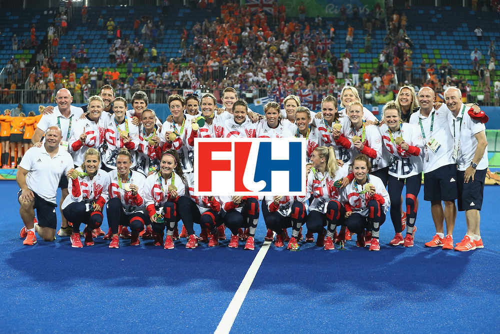 RIO DE JANEIRO, BRAZIL - AUGUST 19:  Team Great Britain pose with their gold medals after defeating Netherlands in the Women's Gold Medal Match on Day 14 of the Rio 2016 Olympic Games at the Olympic Hockey Centre on August 19, 2016 in Rio de Janeiro, Brazil.  (Photo by David Rogers/Getty Images)