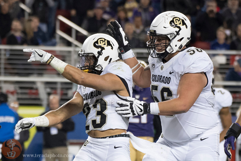 December 2, 2016; Santa Clara, CA, USA; Colorado Buffaloes running back Phillip Lindsay (23) is congratulated by offensive lineman Tim Lynott (56) for scoring a touchdown against the Washington Huskies during the first quarter in the Pac-12 championship at Levi's Stadium.