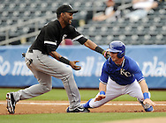 SURPRISE, AZ - MARCH 06:  Alexei Ramirez #10 of the Chicago White Sox makes a tag against the Kansas City Royals on March 6, 2014 at The Ballpark in Surprise in Surprise, Arizona. (Photo by Ron Vesely)   Subject: Alexei Ramirez