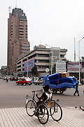 An amputee in a wheelchair looks down the busy Boulevard du 30 Juin from the Place De La Gare, the largest street in the city of Kinshasa...© Zute Lightfoot.www.lightfootphoto.com